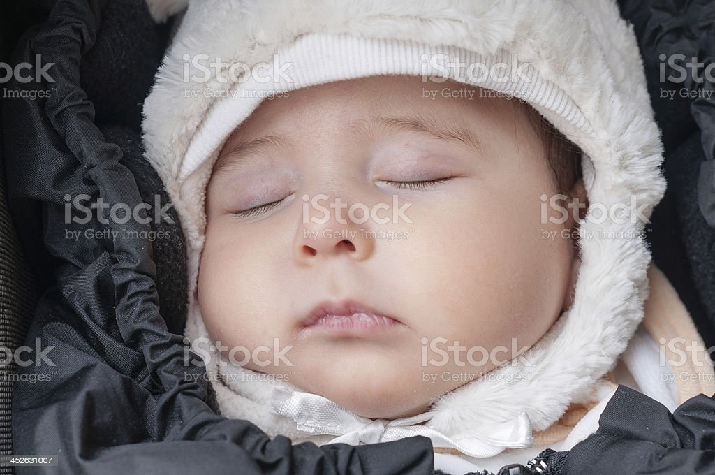 Portrait of a sleeping four month old baby girl stock photo