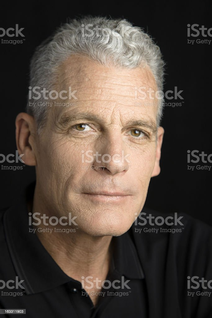 Portrait of a slightly aged man with grey hair stock photo