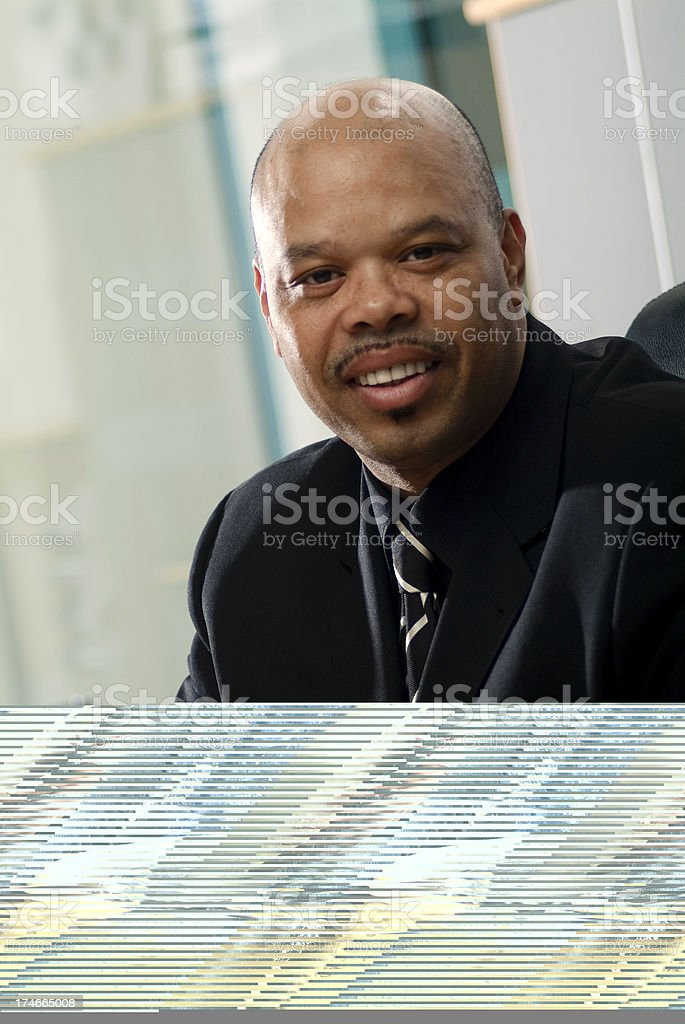 Portrait of a smart business man sat at office desk. royalty-free stock photo