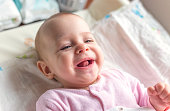 Portrait of a smiling baby laying