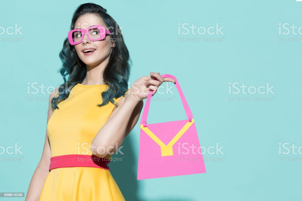 Portrait of a smiling beautiful woman with paper accessories stock photo