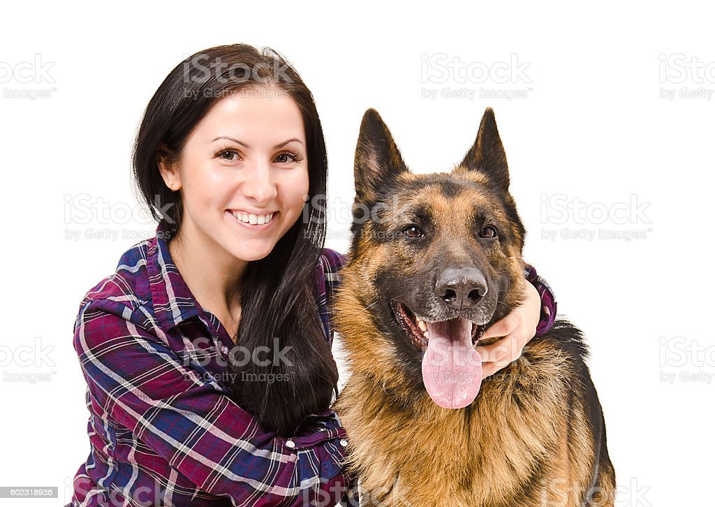 Portrait of a smiling beautiful young woman and German Shepherd stock photo