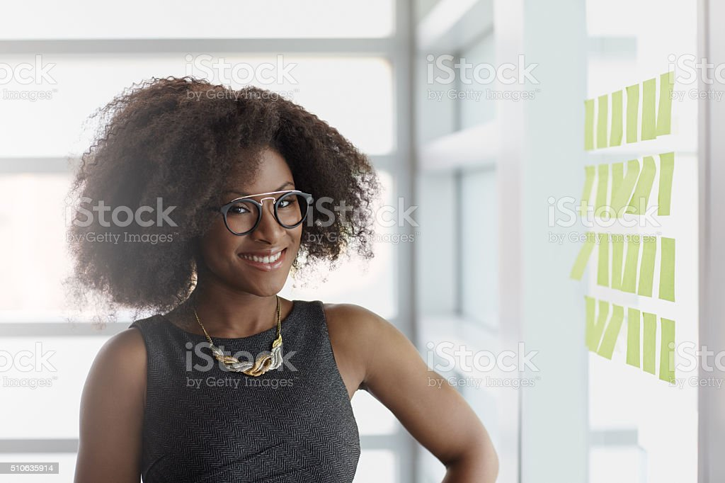 Portrait of a smiling business woman with an afro in stock photo