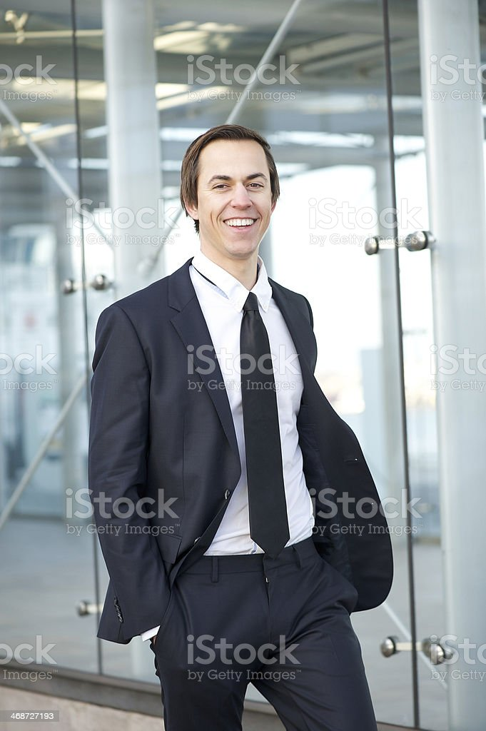 Portrait of a smiling businessman walking in the city royalty-free stock photo