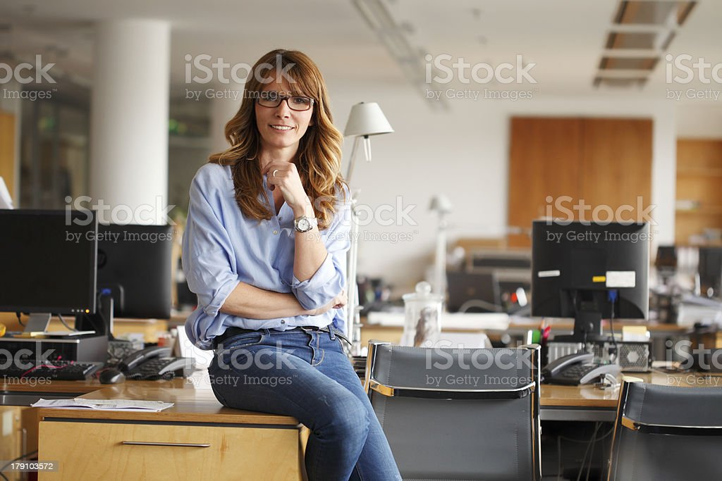 Portrait of a smiling businesswoman in office stock photo