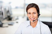 Portrait of a smiling businesswoman wearing headset
