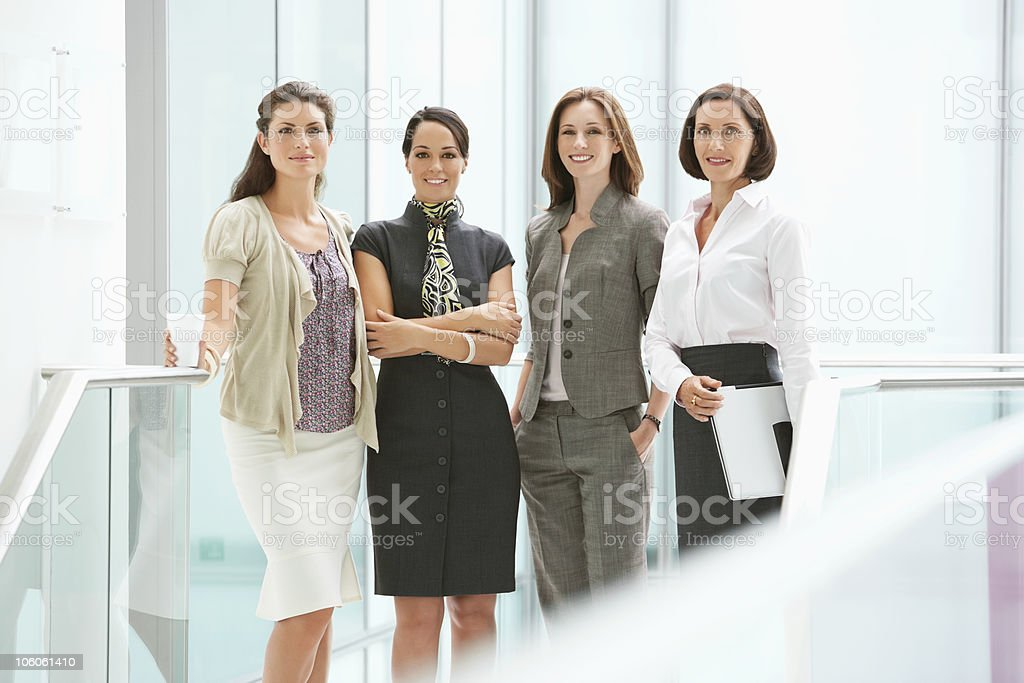 Portrait of a smiling businesswomen standing in corridor royalty-free stock photo