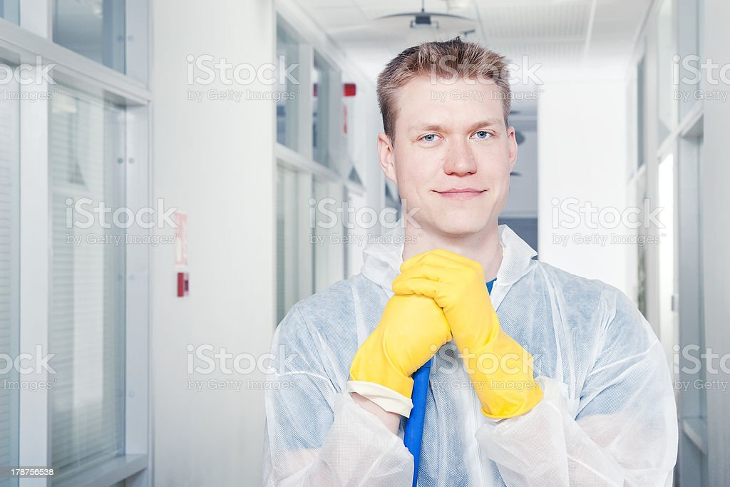 Portrait of a smiling cleaner man wearing protective coveralls stock photo
