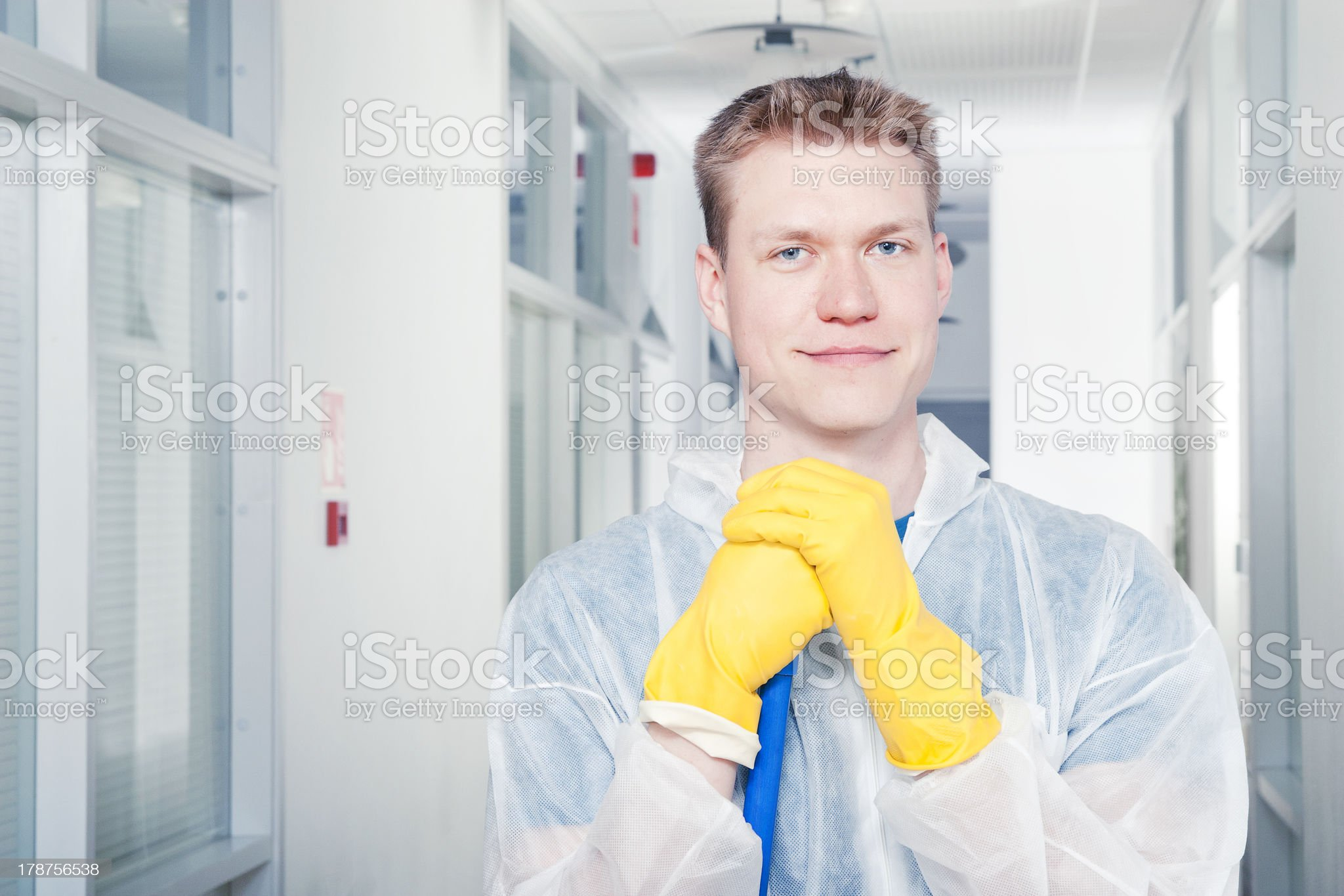 Portrait of a smiling cleaner man wearing protective coveralls royalty-free stock photo