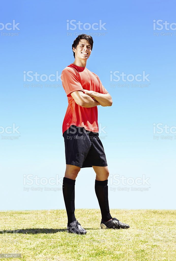 Portrait of a smiling confident footballer royalty-free stock photo