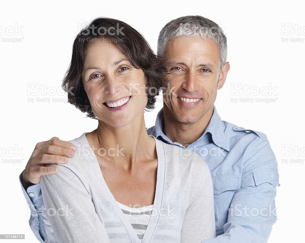 Portrait of a smiling couple over white background royalty-free stock photo