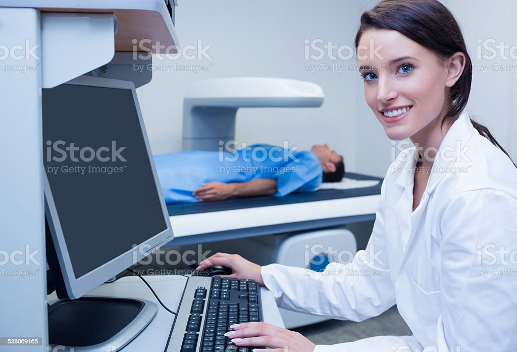 Portrait of a smiling doctor in radiography room stock photo