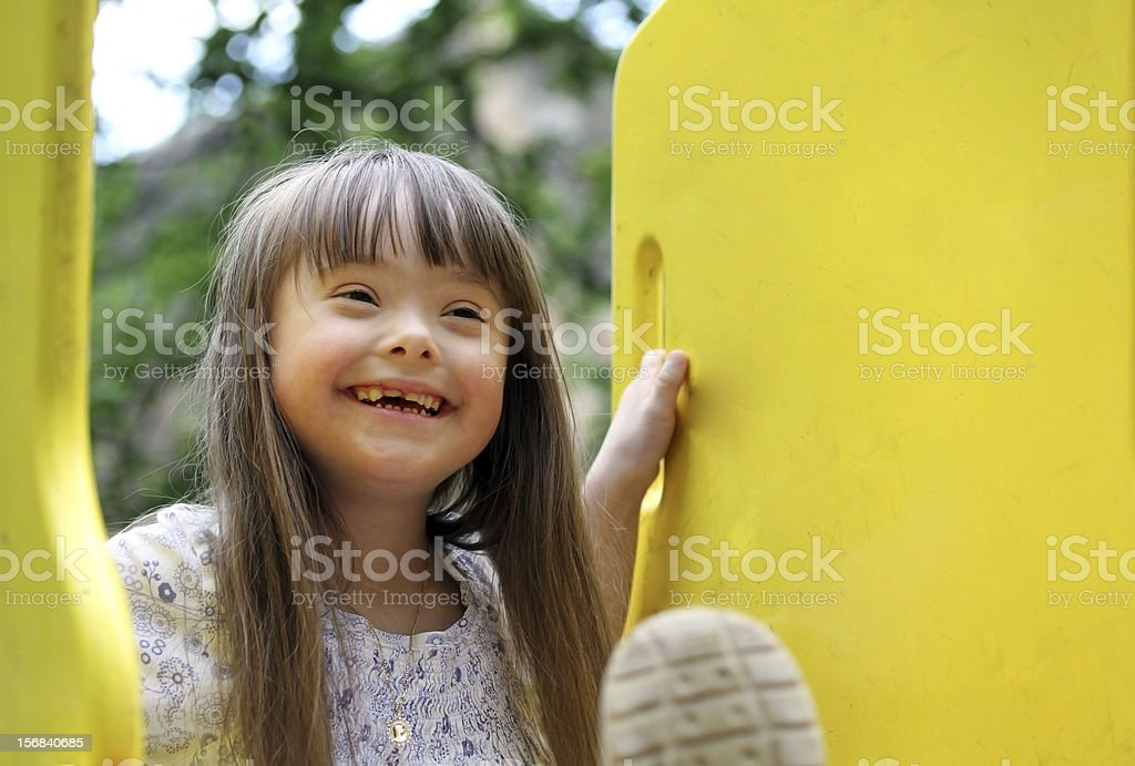 Portrait of a smiling girl playing stock photo