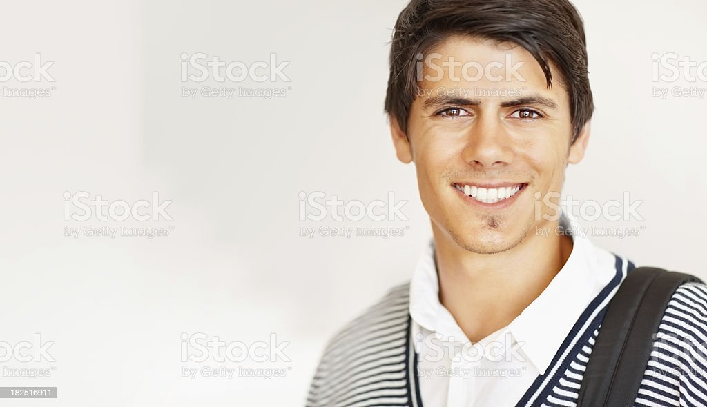Portrait of a smiling handsome college student royalty-free stock photo