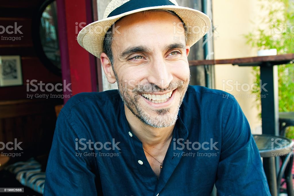 Portrait of a smiling handsome middle age man stock photo