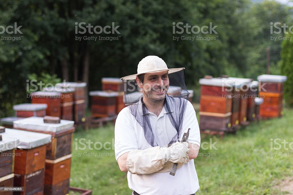 Portrait of a smiling male beekeeper royalty-free stock photo