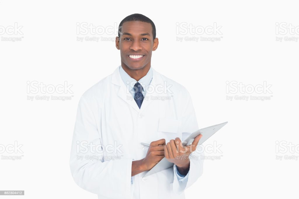Portrait of a smiling male doctor with clipboard stock photo