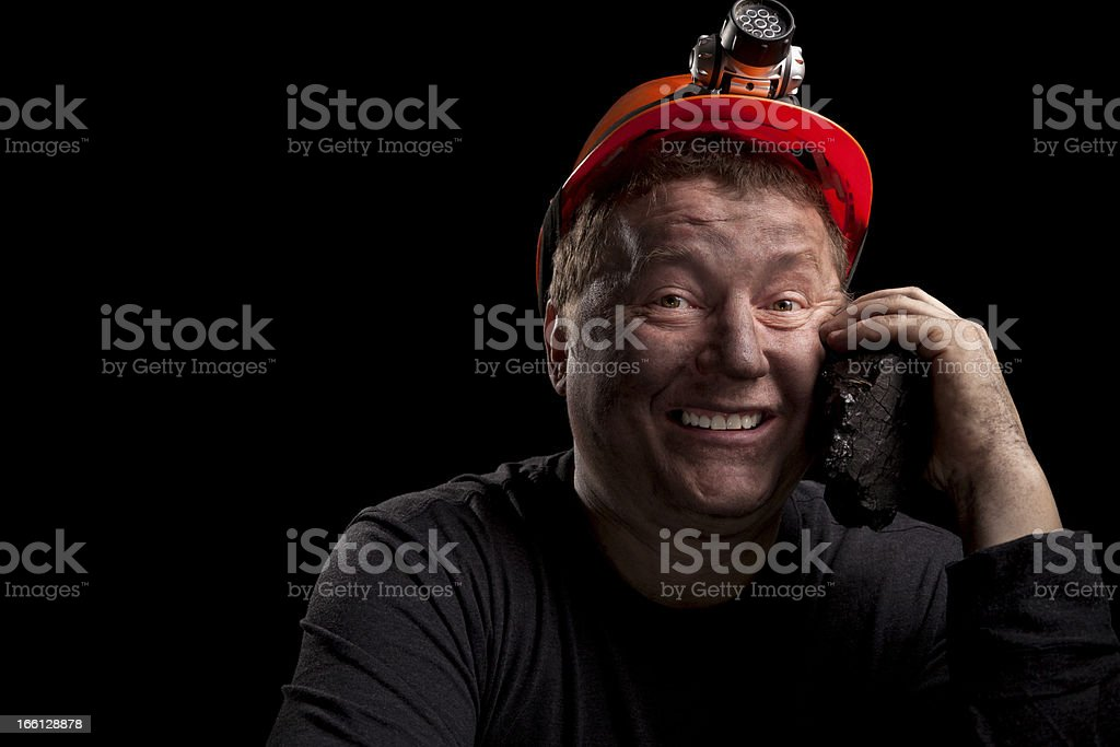 portrait of a smiling man miner royalty-free stock photo