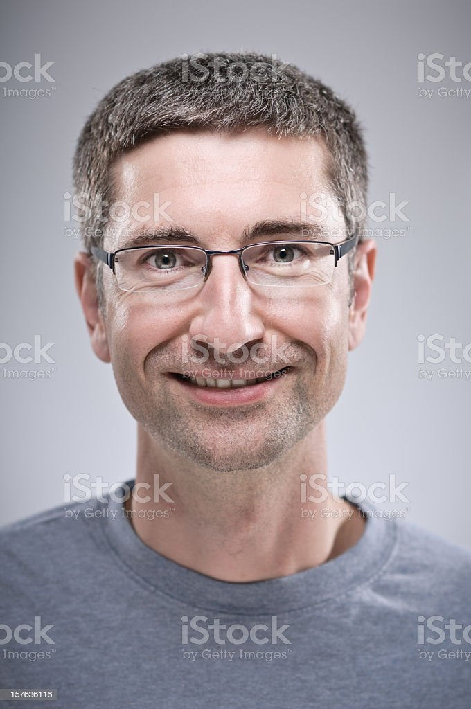 A portrait of a smiling man with glasses royalty-free stock photo