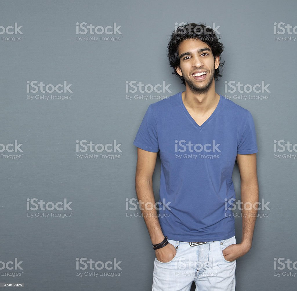Portrait of a smiling man with hands in pocket stock photo