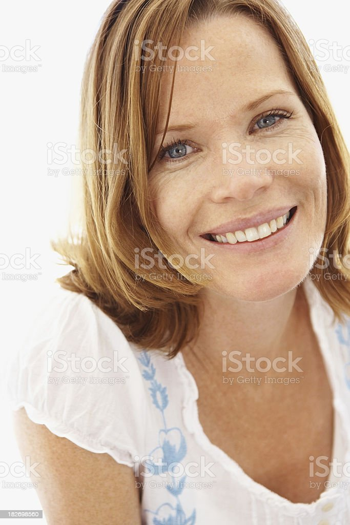Portrait of a smiling mid adult female against white background royalty-free stock photo