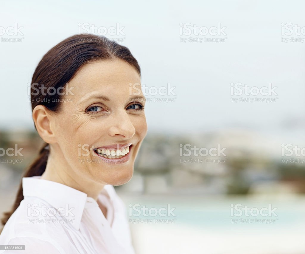 Portrait of a smiling mid adult lady royalty-free stock photo