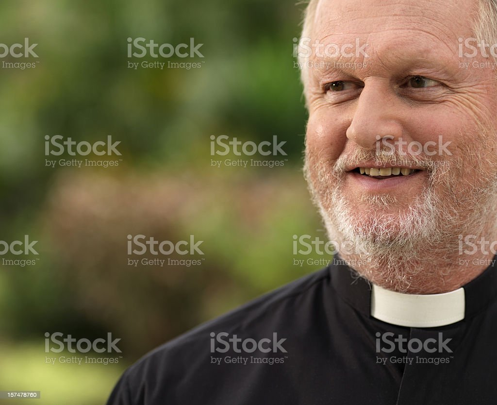 Portrait of a smiling priest stock photo