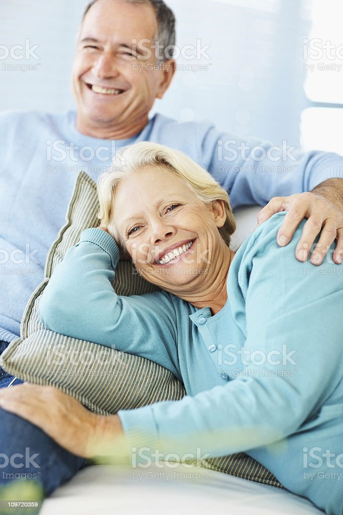 Portrait of a smiling retired couple at home royalty-free stock photo