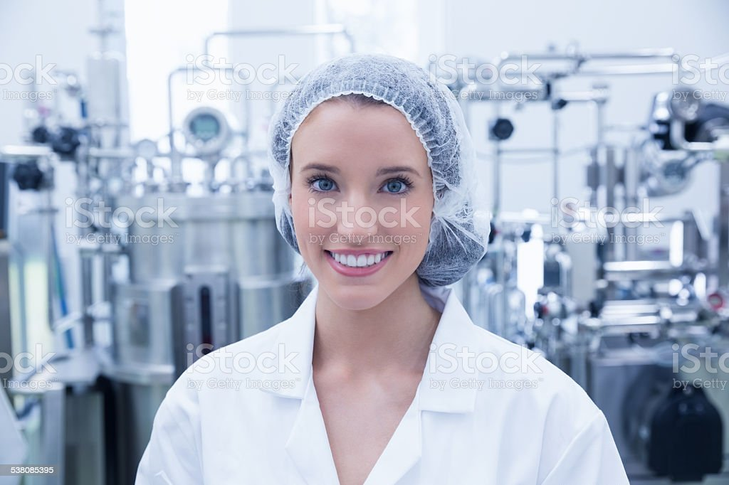 Portrait of a smiling scientist wearing hair net stock photo