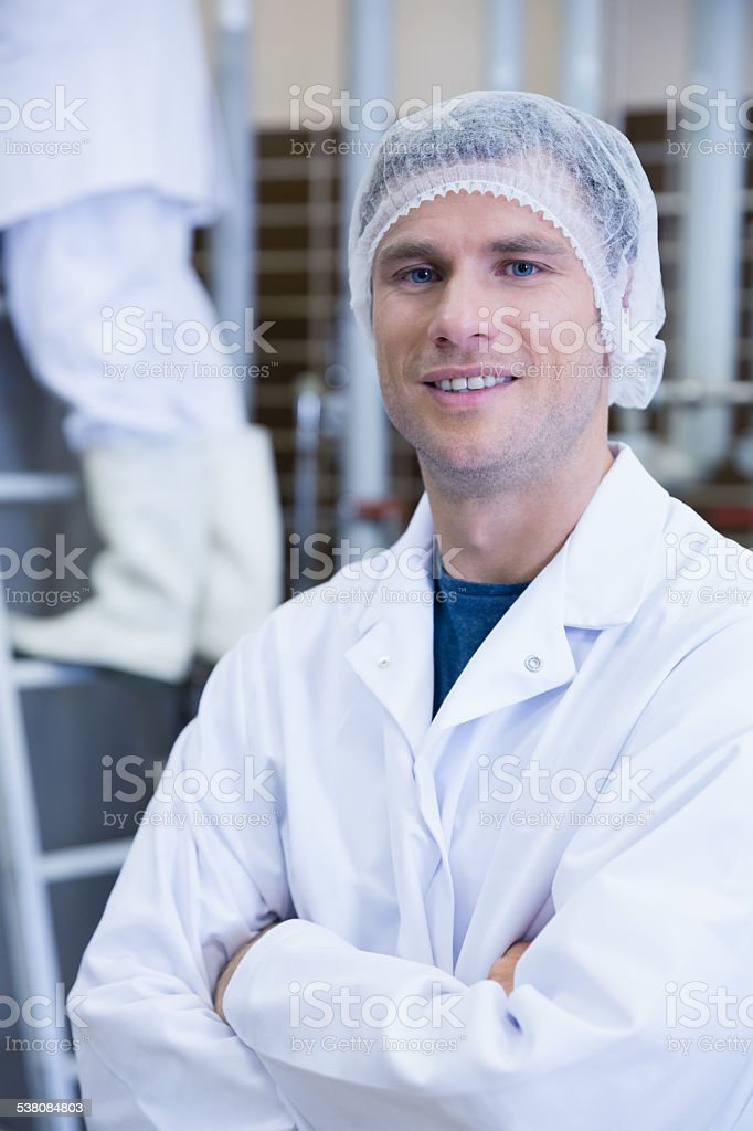 Portrait of a smiling scientist with arms crossed stock photo