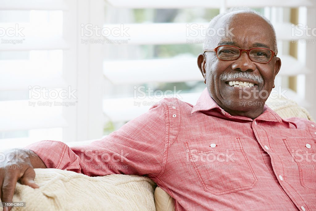 Portrait of a smiling senior man at home stock photo