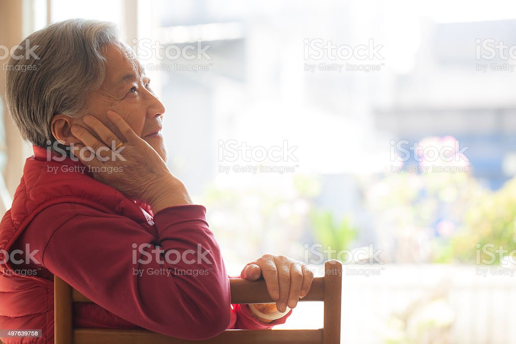 Portrait of a smiling senior woman of East Asian ethnicity stock photo