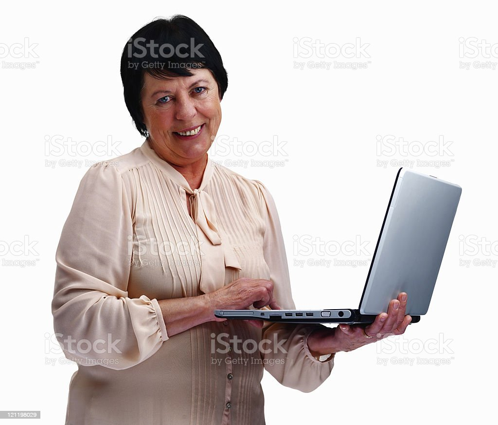 Portrait of a smiling senior woman using laptop over white royalty-free stock photo
