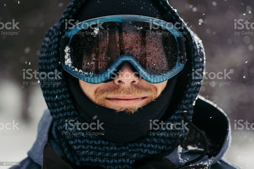 Portrait of a smiling snowboarder stock photo