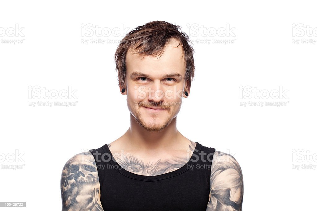 Portrait of a smiling tattooed man royalty-free stock photo
