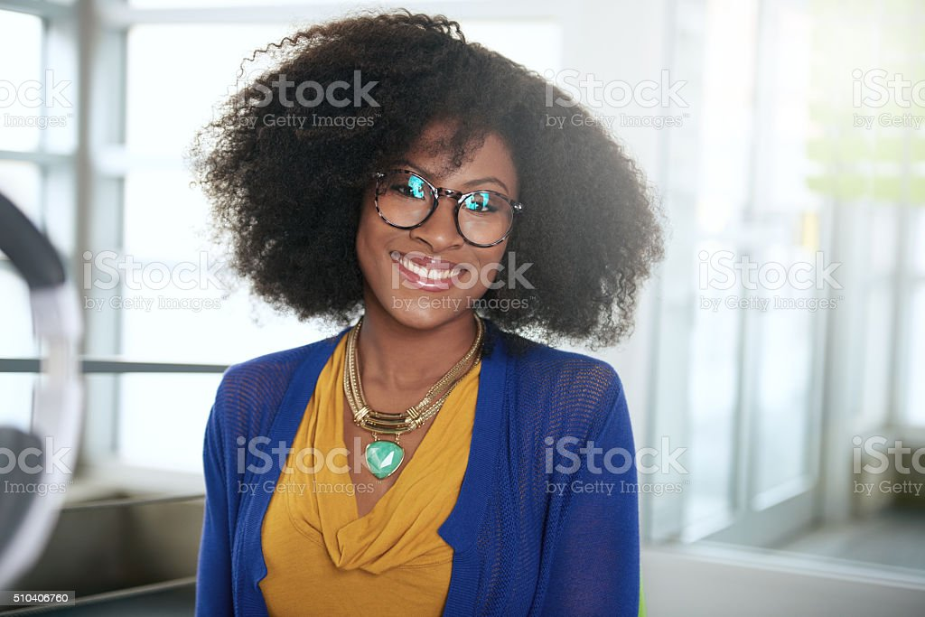 Portrait of a smiling woman with an afro at the stock photo