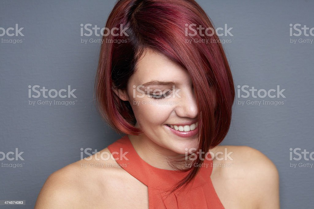 Portrait of a smiling woman with eyes closed stock photo