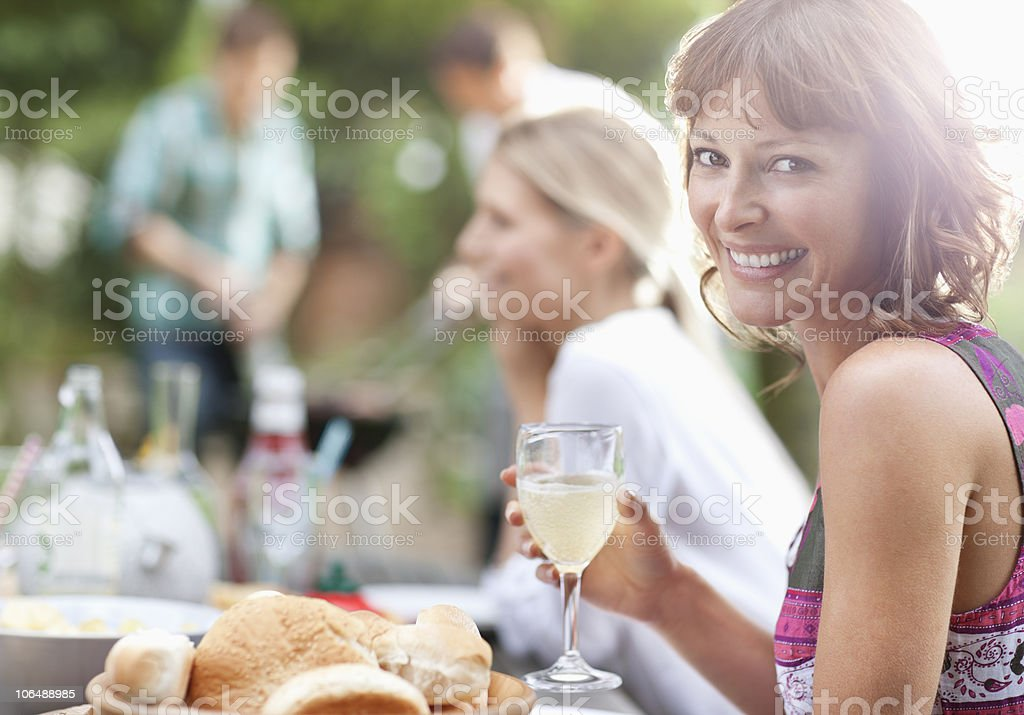 Portrait of a smiling woman with people in the background stock photo