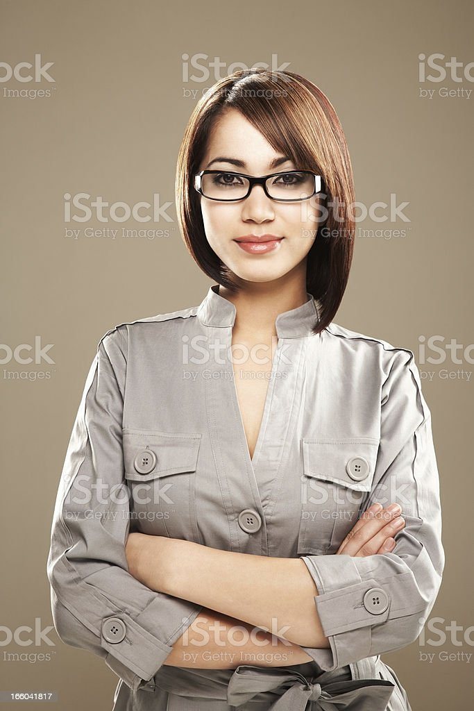 Portrait of a smiling young ethnic business woman in spectacles stock photo