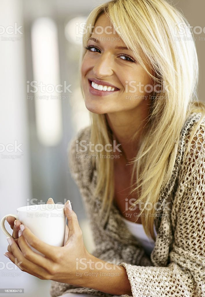 Portrait of a smiling young female holding coffee cup royalty-free stock photo