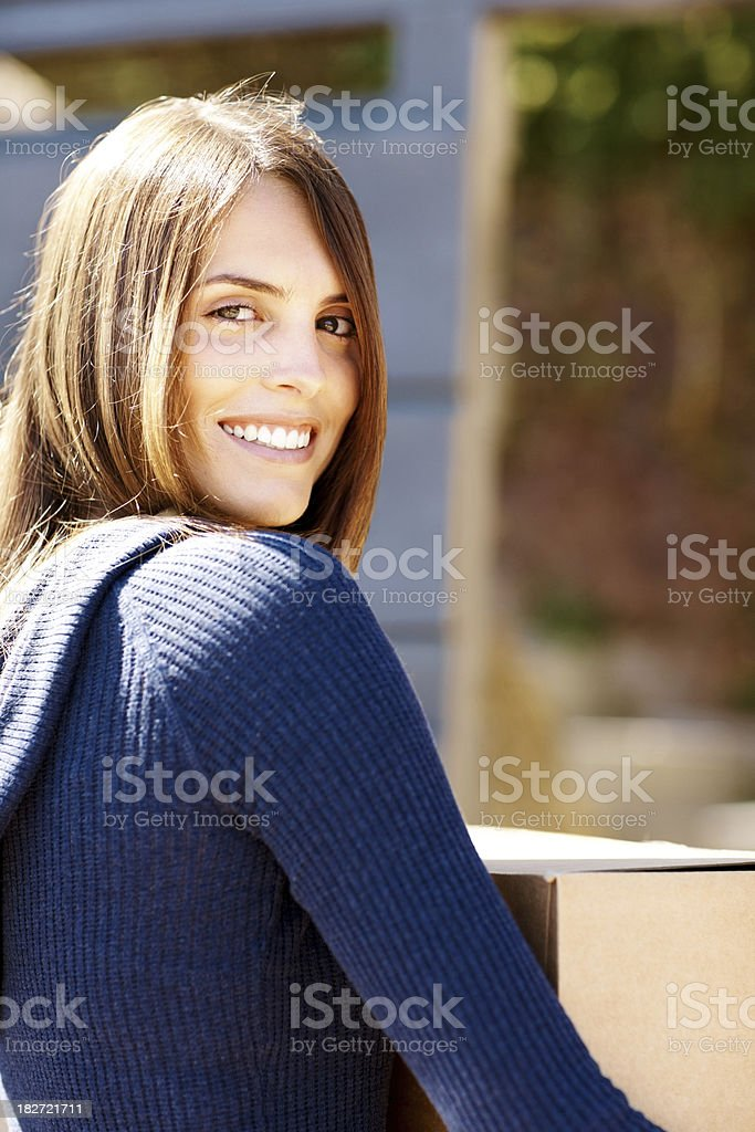 Portrait of a smiling young female shifting house royalty-free stock photo