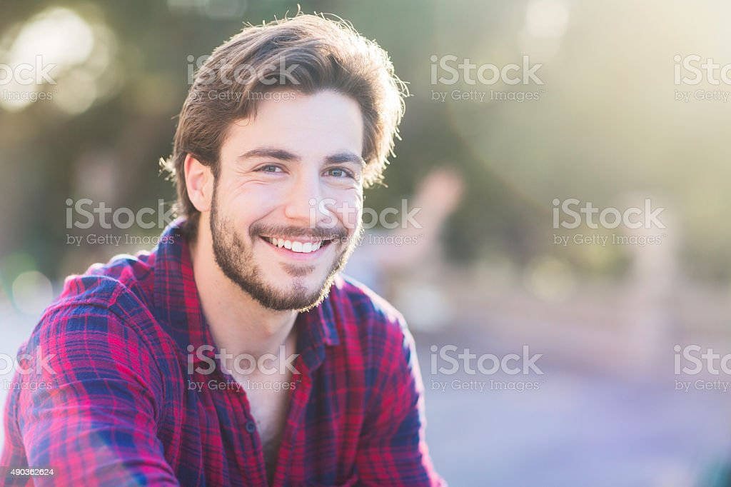Portrait of a smiling young man in Barcelona. stock photo