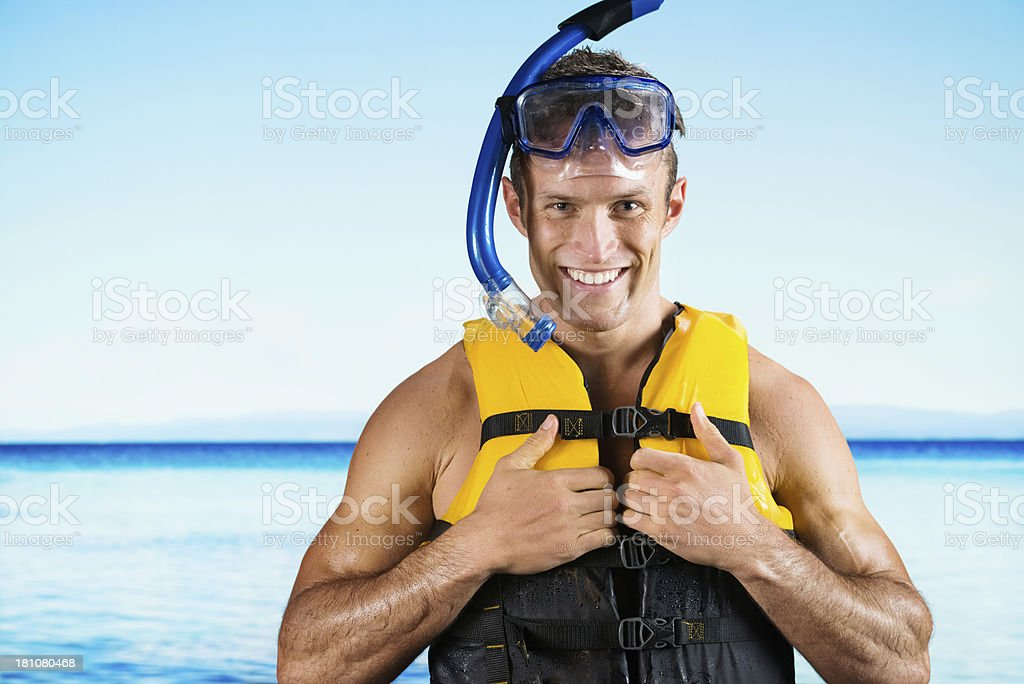 Portrait of a smiling young man with snorkeling royalty-free stock photo