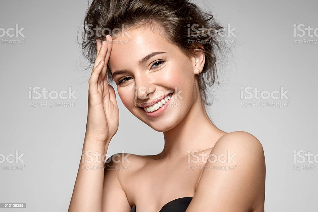 Portrait of a smiling young pretty woman with natural make-up stock photo