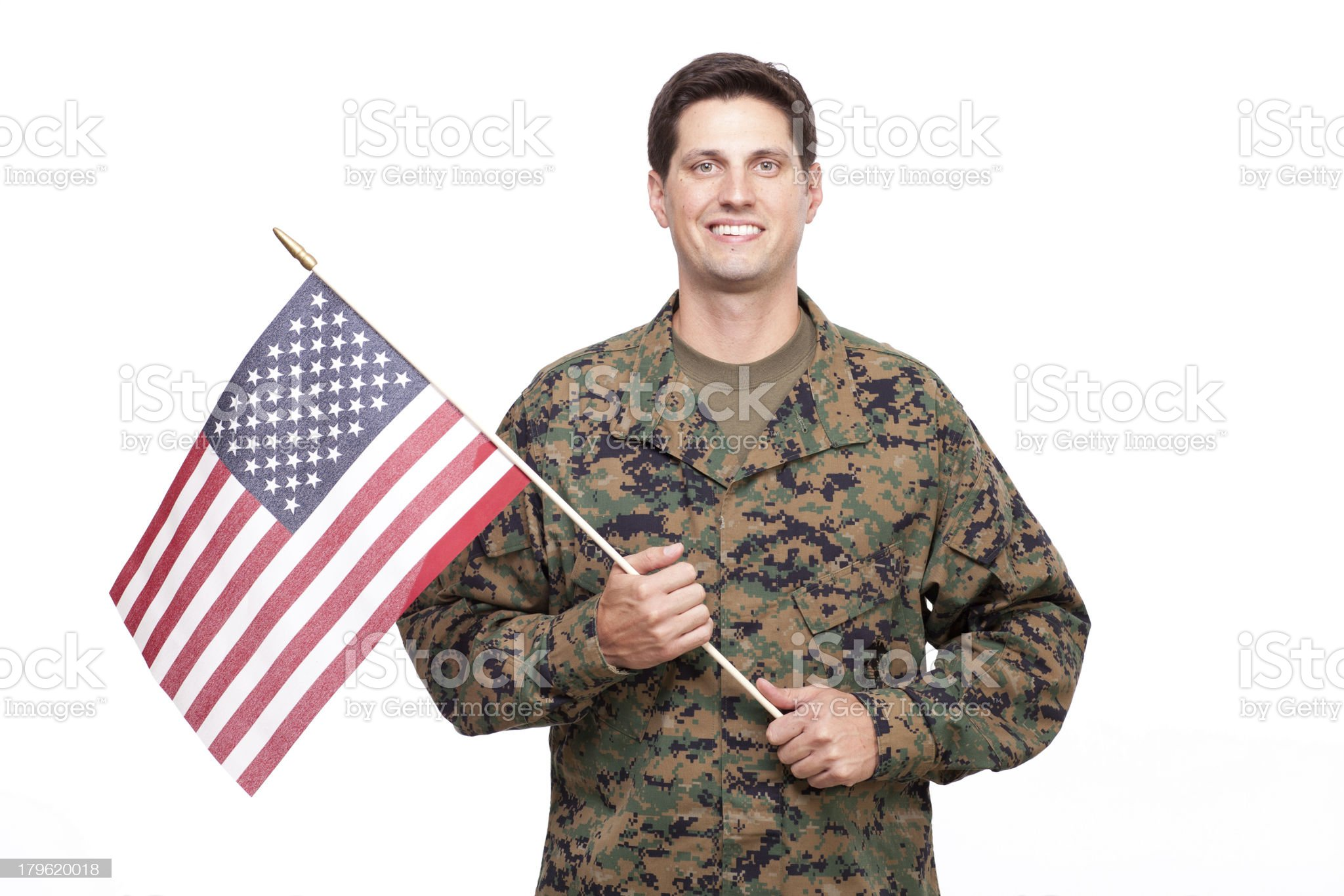 Portrait of a smiling young soldier with American flag royalty-free stock photo