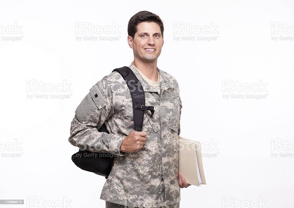 Portrait of a smiling young soldier with backpack and documents royalty-free stock photo