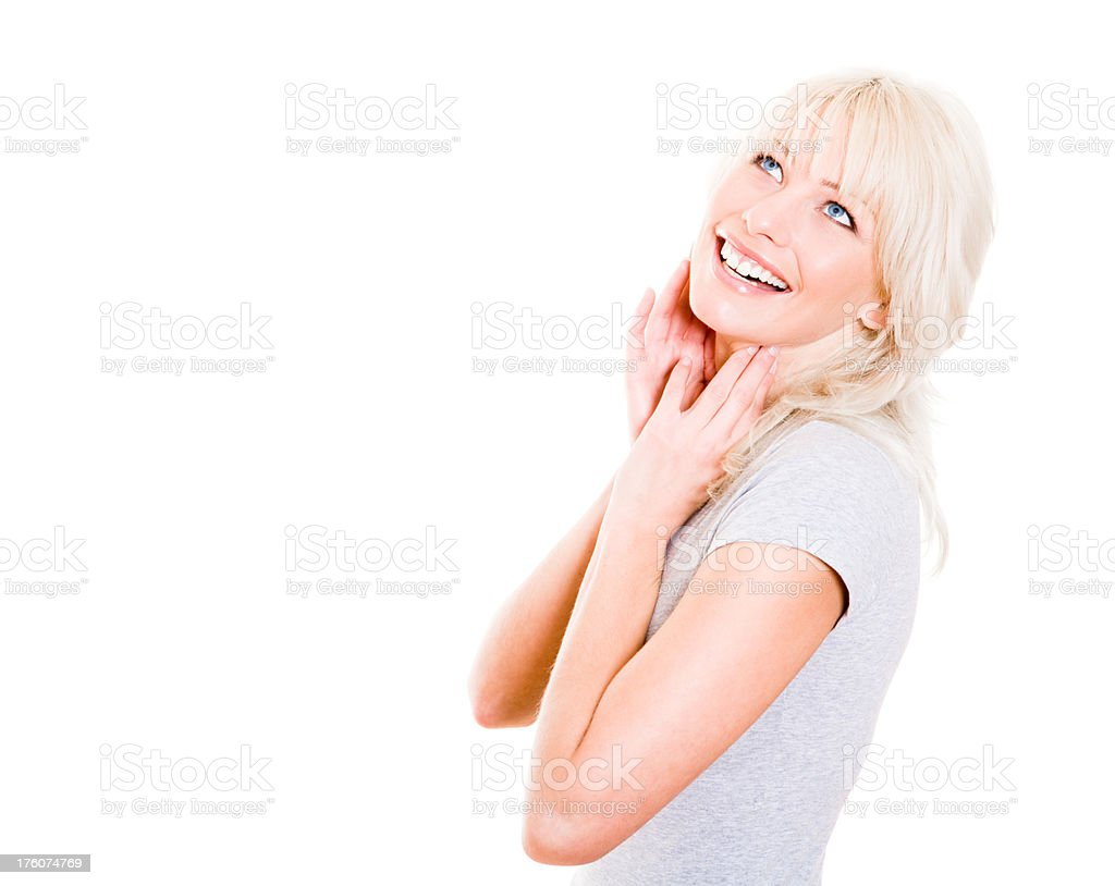 Portrait of a smiling young woman looking up royalty-free stock photo