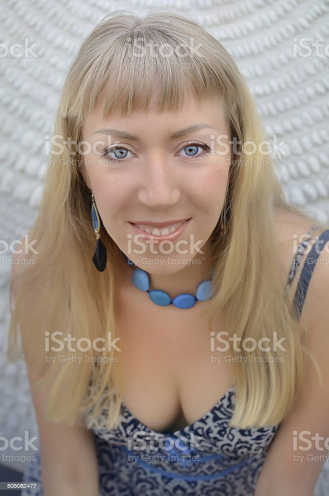 Portrait of a smiling young woman. stock photo