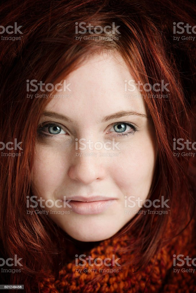 Portrait of a smiling young Woman with red hair stock photo