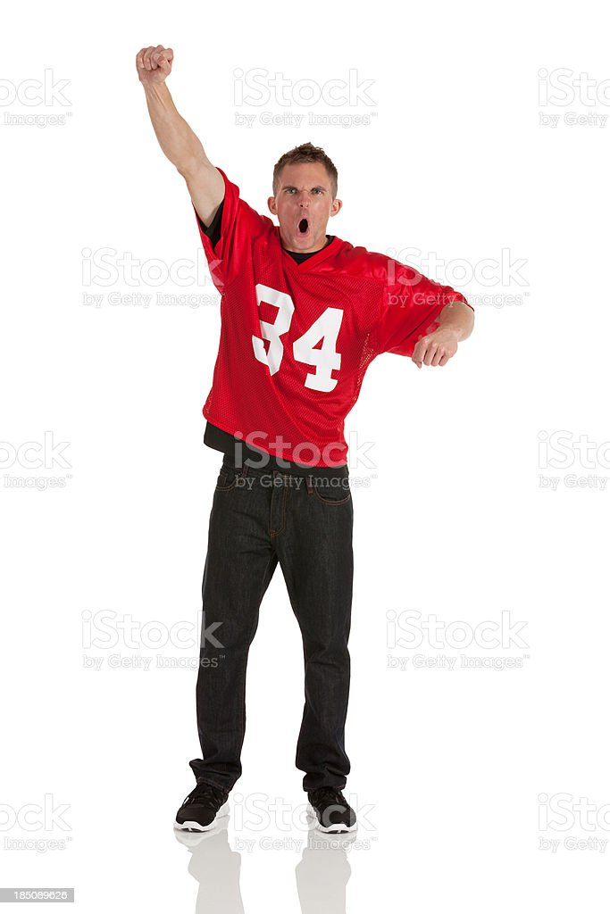 Portrait of a sports fan cheering stock photo